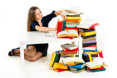 Girl don't want to study and learn, she is pushing away. From herself a stack of books stock images