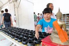 Girl donate money for religious Royalty Free Stock Photo