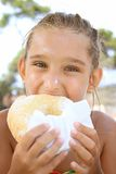 Girl and donut Stock Photography