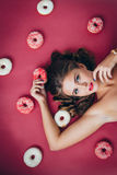 Girl with a donut Stock Photo