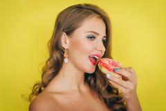 Girl with a donut Stock Photos