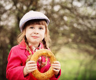 Girl with donut outdoor Stock Image