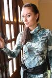 Girl on door Stock Photos