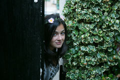 Girl in the door of a garden Royalty Free Stock Photography