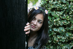 Girl in the door of a garden Royalty Free Stock Image