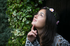 Girl in the door of a garden Royalty Free Stock Images