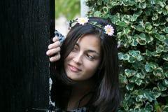 Girl in the door of a garden Stock Image