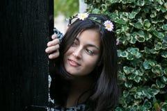 Girl in the door of a garden Royalty Free Stock Photos