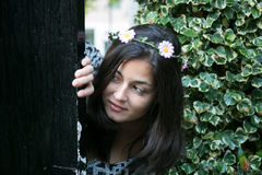 Girl in the door of a garden Stock Photos