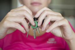 The girl with the door keys. Royalty Free Stock Image