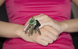 The girl with the door keys. Royalty Free Stock Photos