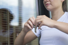 The girl with the door keys. Royalty Free Stock Photo