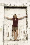 Girl in door of old building Royalty Free Stock Photography