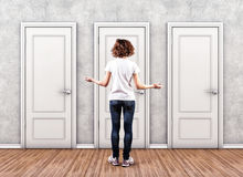 Girl before a doors Royalty Free Stock Image