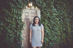 Girl, Doorway, Ivy, Lamp Royalty Free Stock Photography