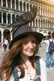 Girl with dove. Girl teenager with dove on Piazza San Marco, venice. Italy stock photography