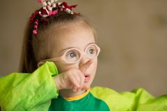 Girl with Down syndrome covered in paint when drawing royalty free stock photo