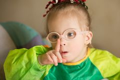 Girl with Down syndrome covered in paint when drawing royalty free stock image