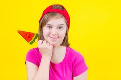 Girl Down syndrome with large Lollipop Stock Image