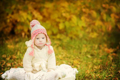 Girl with Down syndrome is resting in autumn park Stock Photography