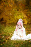 Girl with Down syndrome is resting in autumn park. Girl with Down syndrome  is resting in autumn park Royalty Free Stock Image