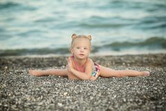 A girl with Down syndrome sitting on the splits Royalty Free Stock Photography