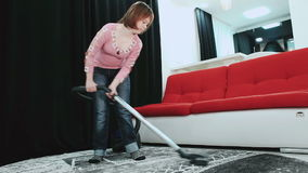 Girl with Down syndrome vacuuming the house. March 21, 2017 World Down Syndrome Day stock footage