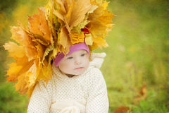 Girl with Down syndrome wore a wreath of spring leaves Stock Image