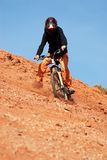Girl downhill. On red loam hills Royalty Free Stock Photos