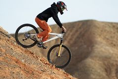 Girl downhill on bike Royalty Free Stock Photo
