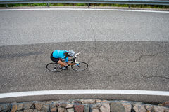 Girl downhill bike race. A woman from above by sport activity Stock Photos