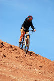 Girl downhill on mountain bike Stock Photos