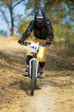 Girl on downhill race. Girl on mountain bike downhill race Royalty Free Stock Image
