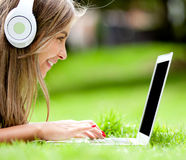 Girl downloading music Royalty Free Stock Image