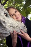 Girl with dragon 04. Teenage girl with her pet dragon.  Photographed outdoors in a New York park.  She was 17 at time of shoot.  taken april 2006 Stock Image