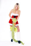 Girl with dragon. Beautiful blonde christmas woman posing with dragon wearing red dress and white fluffy gaiters  on white background Royalty Free Stock Photos