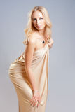 Girl in the drapery. Beautiful seductive girl in golden drapery Stock Photos