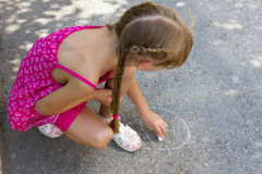 Girl draw on asphalt 5068 Royalty Free Stock Photo