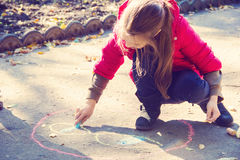 Girl draw with chalk Royalty Free Stock Photo