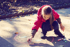 Girl draw with chalk Royalty Free Stock Photos