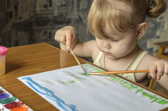Girl draw Stock Images