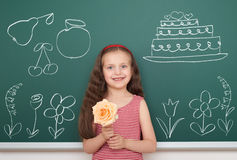 Girl with draw flower and other object on board Royalty Free Stock Images