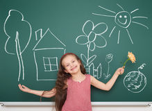 Girl with draw village home and other object Royalty Free Stock Photos