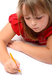 Girl drawin on paper with pencil isolated on white Stock Photos