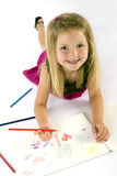 Girl drawing. Little girl drawing on paper Royalty Free Stock Photo