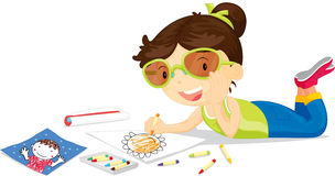Girl Drawing. Girl lying down drawing picture with crayons Royalty Free Stock Photography