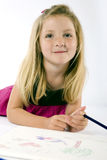 Girl drawing Royalty Free Stock Image