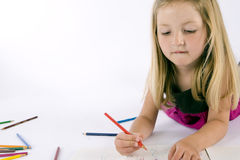 Girl drawing Stock Image