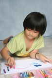 Girl drawing. Little girl doing art painting at home alone Royalty Free Stock Photos