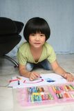 Girl drawing. Little girl doing art painting at home alone Royalty Free Stock Images